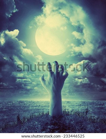 zombie hand coming out of his grave - stock photo