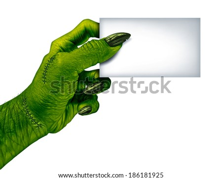 Zombie hand holding a blank card sign on a side view as a creepy halloween or scary symbol with textured green skin wrinkled monster fingers and stitches isolated on a white background.. - stock photo