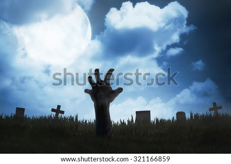 Zombie hand out from the graveyard. Halloween concept - stock photo