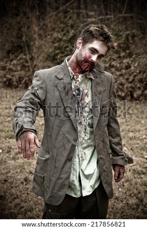 Zombie in a Suit - stock photo