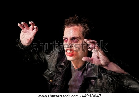 Zombie or ghoul recoiling from a bright light - stock photo