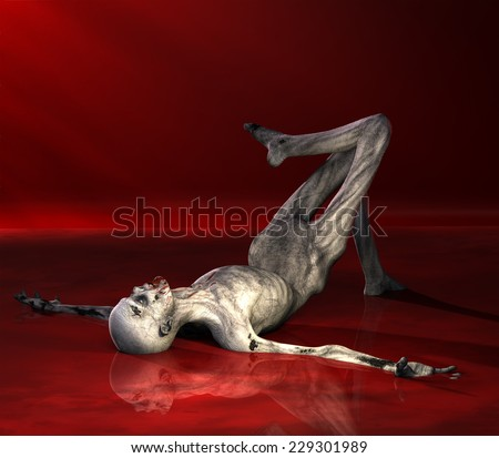 Zombie - Posing.  A zombie is laying in a lake of blood with reflections. Happy Halloween. - stock photo