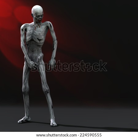 Zombie - Posing.  A zombie is reflecting as he covers his lost member. Happy Halloween. - stock photo