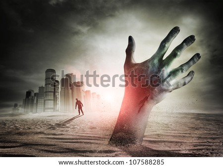 Zombie Rising. A hand rising from the ground! - stock photo