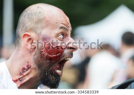 Zombie screaming at Sydney Zombie Walk in Sydney, AU, 31st October, 2015. Zombie Walk is an annual event where thousands of people get involved to raise awareness for Australia's Brain Foundation. - stock photo