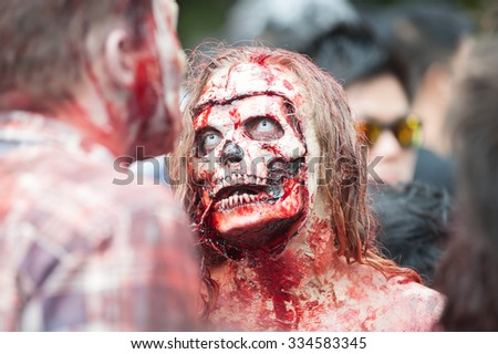 Zombie smile at Sydney Zombie Walk in Sydney, AU, 31st October, 2015. Zombie Walk is an annual event where thousands of people get involved to raise awareness for Australia's Brain Foundation. - stock photo