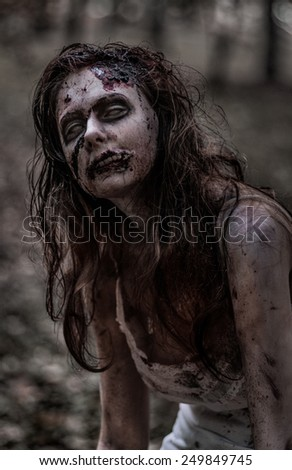 Zombie woman with wounds - stock photo