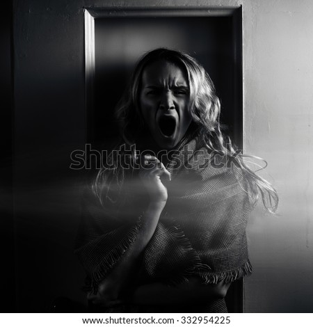 Zombies scream halloween concept, make-up girl without eyes.Young blond terrible woman - stock photo