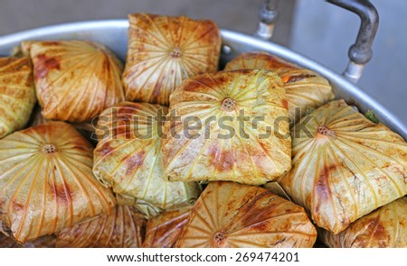 Zongzi in lotus leaf, Chinese Rice Dumplings in market - stock photo