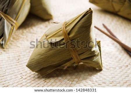 Zongzi or rice dumpling. Traditional steamed sticky  glutinous rice dumplings. Chinese food dim sum. Asian cuisine. - stock photo