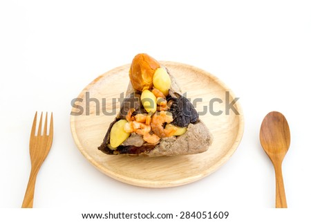 Zongzi or sticky rice dumpling in wood dish and fork on white background - stock photo