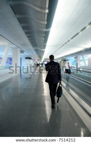 Zoom blur of a businessman at the airport - stock photo