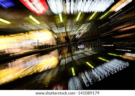 Zoom blurred (with lens) picture of central station. Logotypes cropped. - stock photo