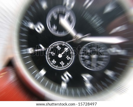 Zoom effect applied to dial of wrist watch - stock photo