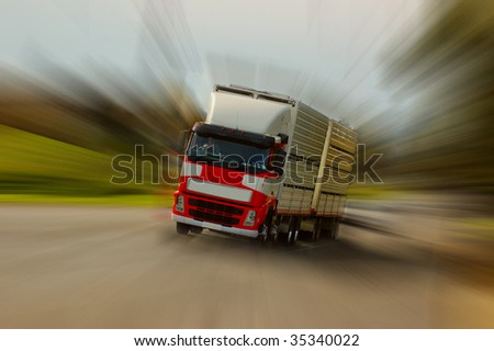 zoom effect applied to image of a moving cattle truck - stock photo