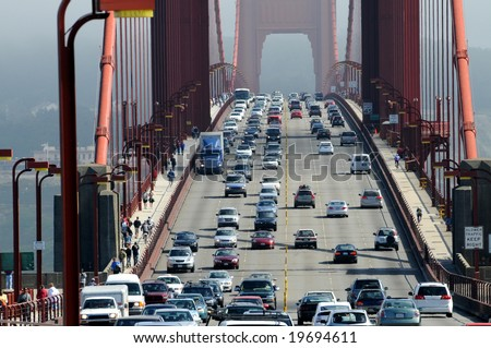 Zoom of heavy traffic on Golden Gate Bridge, connecting San Francisco to Marin County, warm air rising from road and cars in the front - stock photo