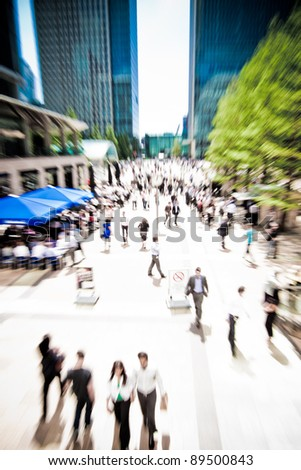 Zoom on business people rushing around at Canary Wharf, London. Motion blur. - stock photo