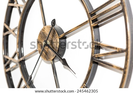 Zoomed antique clock on the wall : white background - stock photo