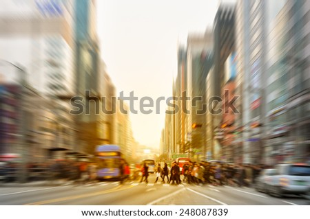 Zoomed blur of pedestrians crossing the street near Gangnam Station in Seoul, South Korea. - stock photo