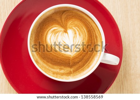 Zoomed cup of coffee with foam heart illustration - stock photo