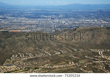 Zoomed in aerial of Phoenix, Arizona from behind South Mountain