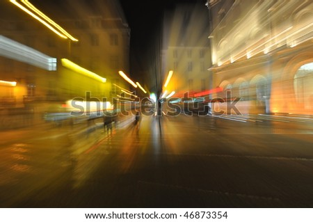 zooming out on a busy street at night in Lisbon, Portugal - stock photo
