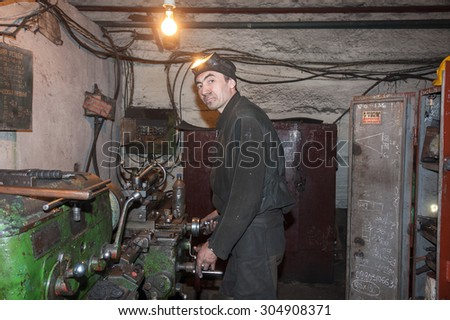 Zorinsk, Ukraine - March 18, 2013: Turner in the workplace. Repair shop mines Nikonorov - New. Lugansk region