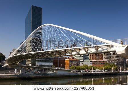 ZUBIZURI BRIDGE - september 07. Zubizuri bridge in the city of Bilbao on september 07, 2012. Zubizuri bridge create by Santiago Calatrava, Abandoibarra, Bilbao, Bizkaia, Spain - stock photo