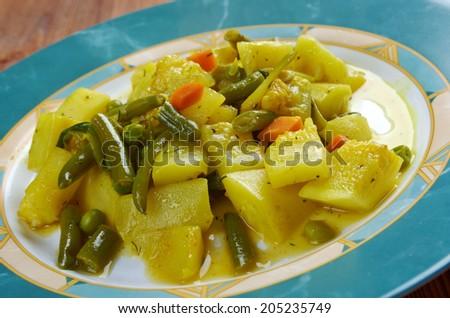 zucchine in umido con uova - Italian cuisine steamed zucchini with spices - stock photo
