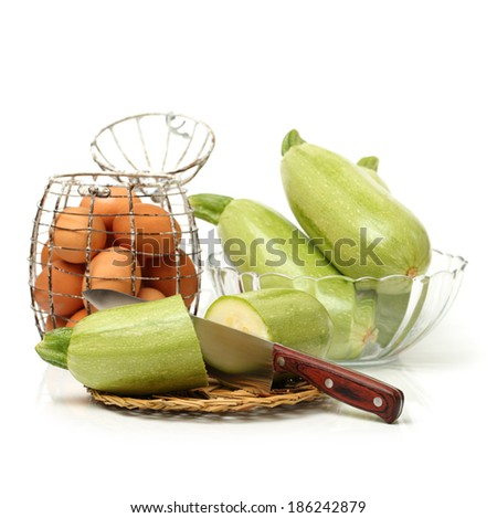 Zucchini and eggs on white background  - stock photo
