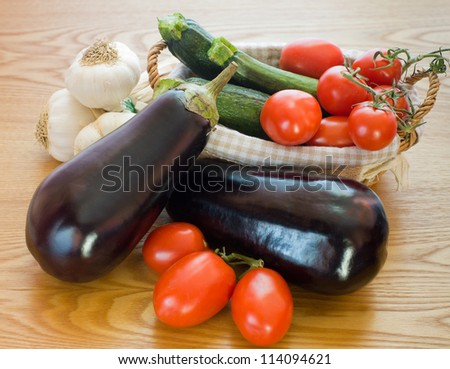 Zucchini, Aubergines, Garlic and tomatoes - stock photo