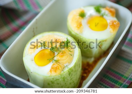 zucchini baked inside with egg and cheese