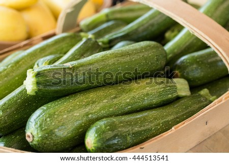 Zucchini for sale in a basket at farmers market in Asheville North Carolina