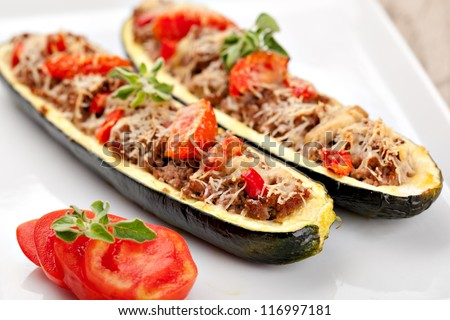 Zucchini halves stuffed with minced meat and vegetable - stock photo