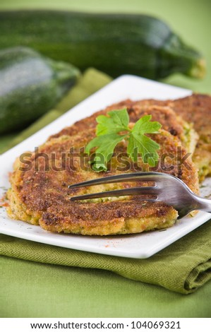 Zucchini omelettes. - stock photo