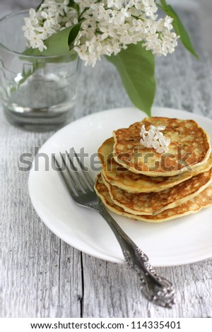 zucchini pancakes on a white plate