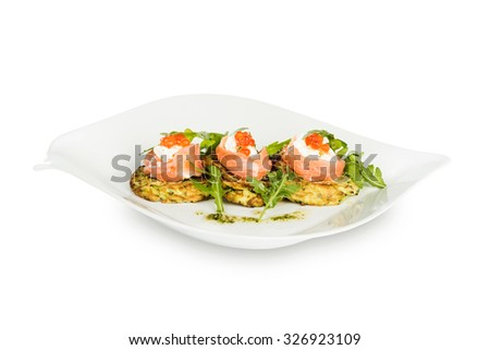 zucchini pancakes with salmon and cream cheese on a plate - stock photo