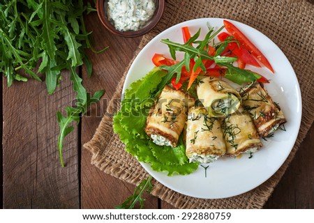 Zucchini rolls with cheese and dill. Top view - stock photo