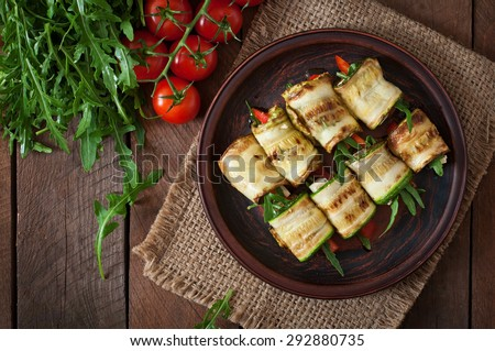 Zucchini rolls with cheese, bell peppers and arugula. Top view - stock photo