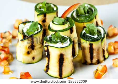 zucchini rolls with goat cheese - stock photo