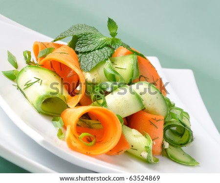 Zucchini salad with carrots and garlic marinade with herbs - stock photo