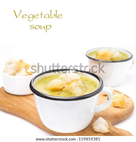 zucchini soup with croutons, isolated on white background - stock photo