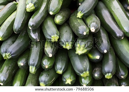 Zucchini squash on display at the farmer's market - stock photo