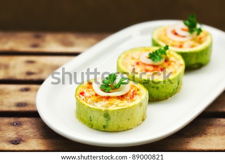 Zucchini stuffed with cheese and vegetables  (shallow dof)