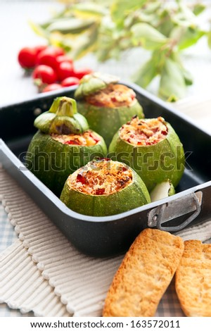 Zucchini stuffed with cherry tomato and parmesan