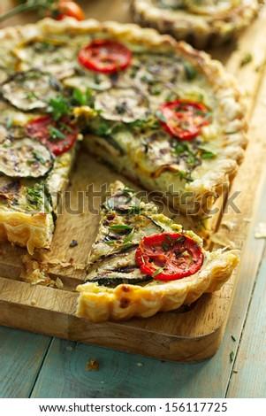 Zucchini tart with tomato and herbs - stock photo