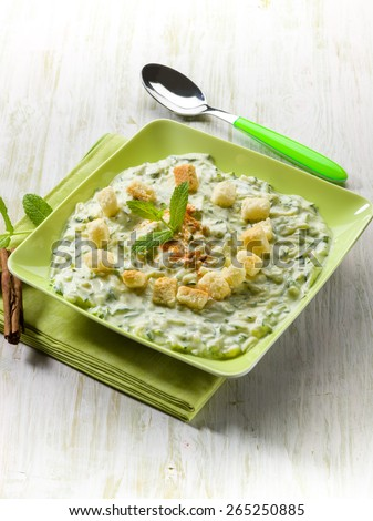zucchinis cream with cinnamon and bread - stock photo