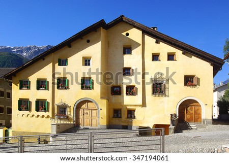 ZUOZ, SWITZERLAND - JUNE 26, 2015: The ancient traditional house in historic medieval old town. The Zuoz today is one of the best preserved villages of the Upper Engadin. - stock photo