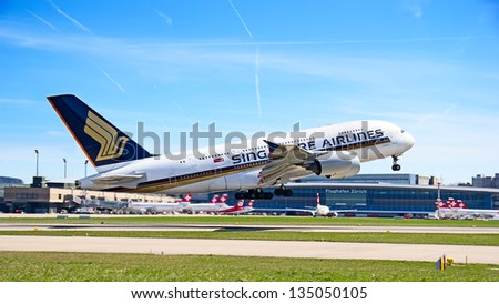 ZURICH - APRIL 14:Singapore Airlines Airbus A380 taking off on April 14, 2013 in Zurich, Switzerland. A380 is the biggest civil aircraft of the world. - stock photo