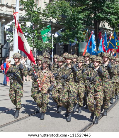 ZURICH - AUGUST 1: Infantry division of the Swiss army participating in the Swiss National Day parade on August 1, 2009 in Zurich, Switzerland. - stock photo